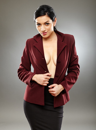 Sexy braless hispanic businesswoman with only her jacket, partly letting beautiful breasts to be seen