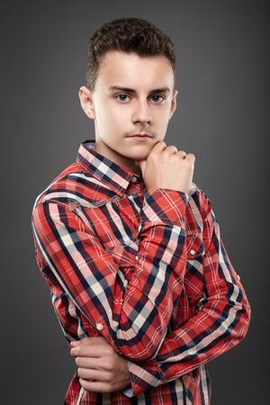 boy body: Studio shot of a caucasian teenage boy on gray  Stock Photo
