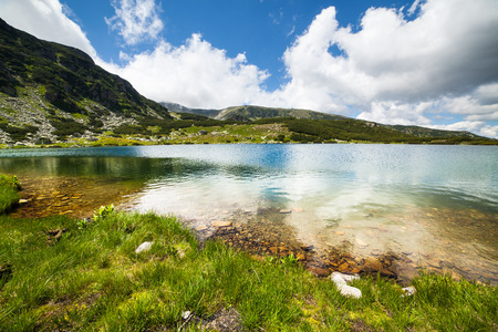 Summer alpine landscape with lake Calcescu in Romanian Parang mountains