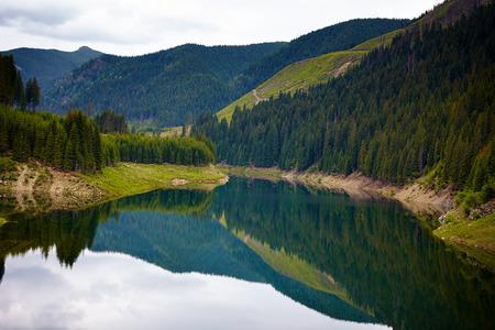 Landscape of lake Galbenu in Romania in a cloudy day photo