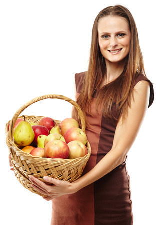 Young caucasian woman with a basket of apples and pears isolated on white background photo