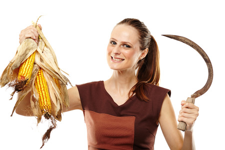 reaping: Young woman with a reaping hook and corn cobs isolated on white background
