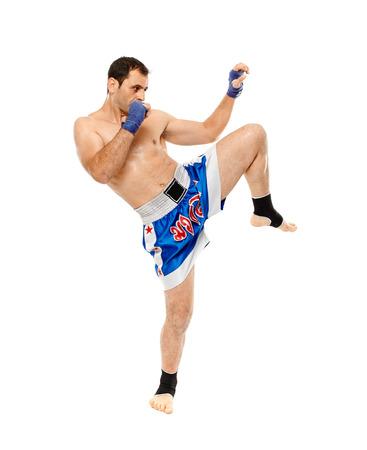thai boxing: Muay thai or kickboxer executing a powerful kick, isolated on white background Stock Photo
