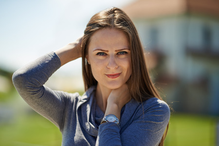 Beautiful caucasian young woman outdoor near her house, closeup with selective focus photo