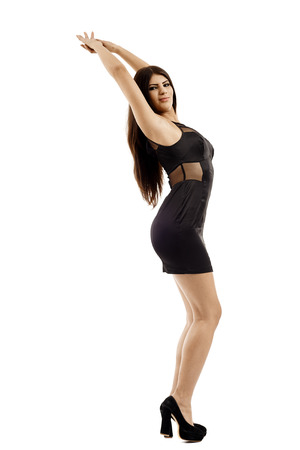 Full length of a latin woman in black dress on gray background photo