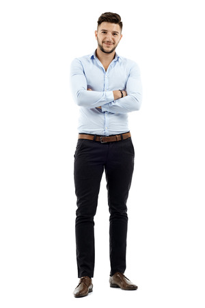 Full length of a young caucasian businessman with arms folded Stock Photo