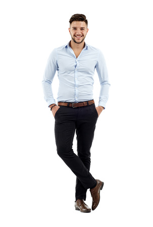 Full length of a young caucasian businessman with hands in his pockets Standard-Bild