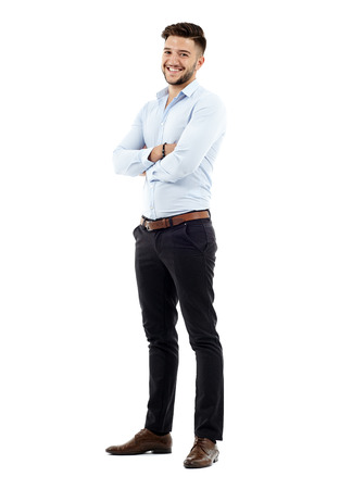 Full length of a young caucasian businessman with arms folded Stockfoto