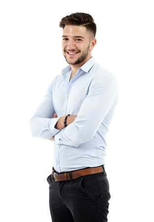 Full length of a young caucasian businessman with arms folded Standard-Bild