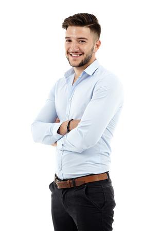 pleine longueur d'un jeune homme d'affaires caucasien, les bras croisés Banque d'images
