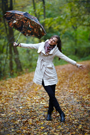 Young caucasian woman taking a walk in the forest, autumnal portrait photo