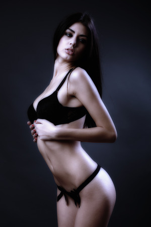 Toned glamour image of a gorgeous hispanic woman in black lingerie photo