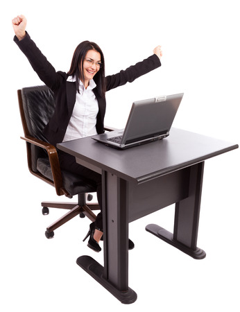 Happy caucasian businesswoman expressing joy, sitting at her desk isolated on white background photo
