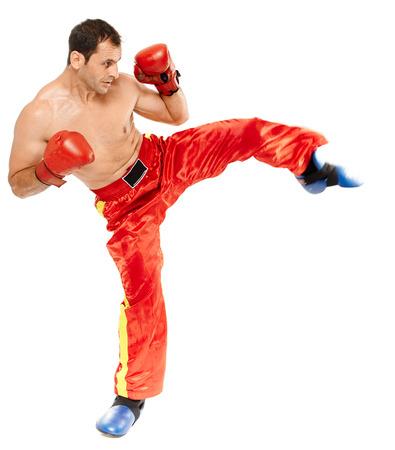 Kickbox or muay thai instructor executing a kick, isolated on white background Stock Photo
