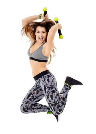 Fitness young woman doing cardio aerobic exercises with light dumbbells photo