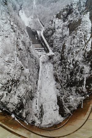 The dam from Vidraru lake in Romania, winter time photo