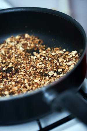 ground nuts: Ground nuts mix dry frying in the pan on stove Stock Photo