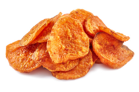spicy: Closeup of a pile of homemade sweeet potatoes chips isolated on white background Stock Photo