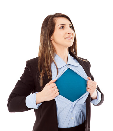 Confident businesswoman opening her shirt in superhero style isolated on white background