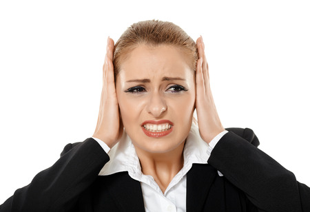 hands over ears: Closeup portrait of a shocked businesswoman with hands over ears, isolated on white background