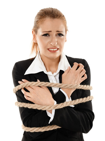 young businesswoman tied with a rope photo