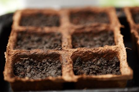 nurseries: Closeup of peat nurseries for seedlings filled with soil Stock Photo