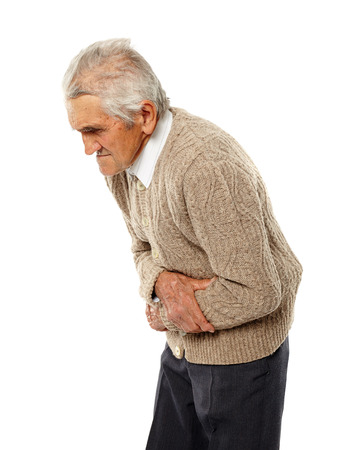 Old man with severe abdominal pain isolated on white Stock Photo