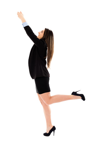 Ambitious businesswoman climbing on imaginary rope, conceptual shot photo