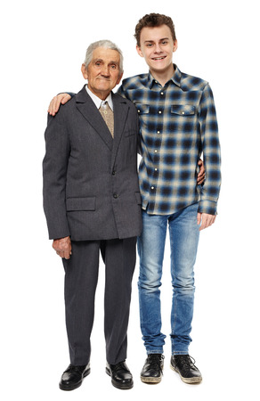 older age: Grandfather and grandson posing in full length portrait, isolated on white background Stock Photo