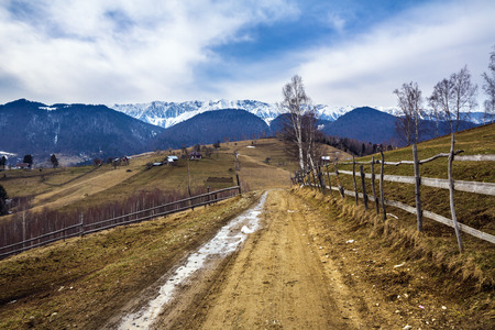 mud snow: Rural empty road on the mountains