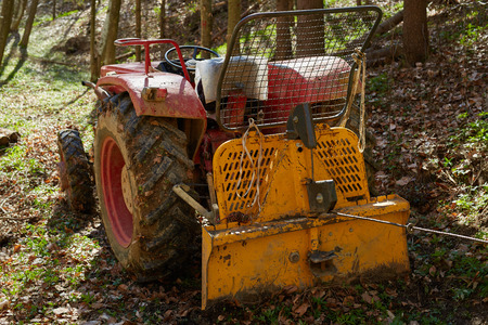 logging: Logging tractor with an anchor winch in the forest Stock Photo