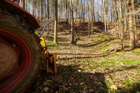 hauling: Logging tractor with an anchor winch in the forest Stock Photo
