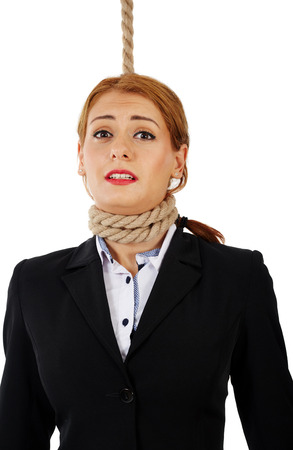 sentenced: Scared business woman with noose around her neck, about the get hanged Stock Photo