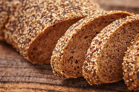 Closeup of rye bread with seeds on a wooden board photo