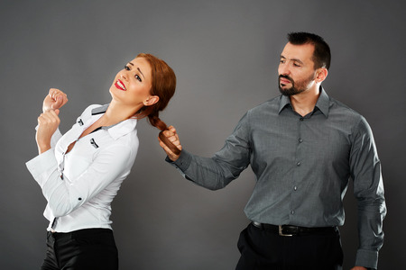 disdain: Aggressive and dominating boss pulling his female employees hair