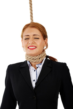 woman rope: Scared business woman with noose around her neck, about the get hanged Stock Photo