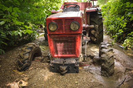 Tractor stuck in the mud on a river