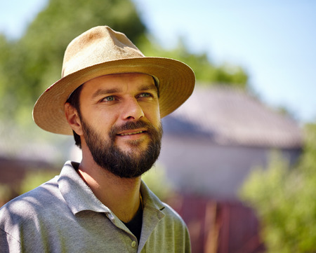 hansome: Closeup portrait of a hansome bearded young farmer outdoor