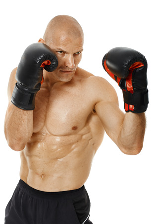thai boxing: Muscular kickbox or muay thai fighter punching, isolated on white background