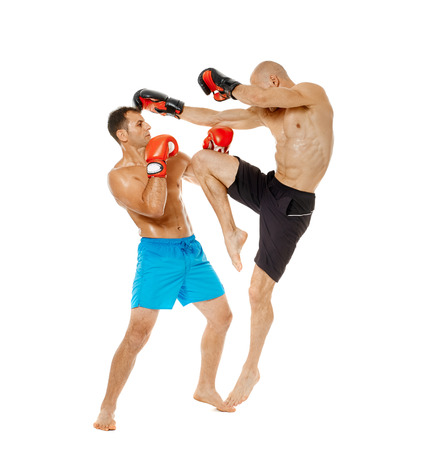 Two kickbox fighters sparring, full length isolated on white background Stock Photo