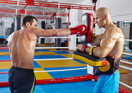 thai arts: Two muay thai fighters in a sparring match in the ring
