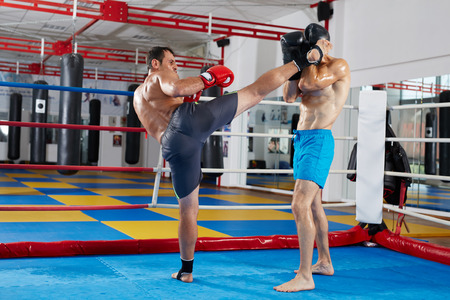 thai: Two muay thai fighters in a sparring match in the ring