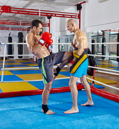 elbow pads: Two muay thai fighters in a sparring match in the ring