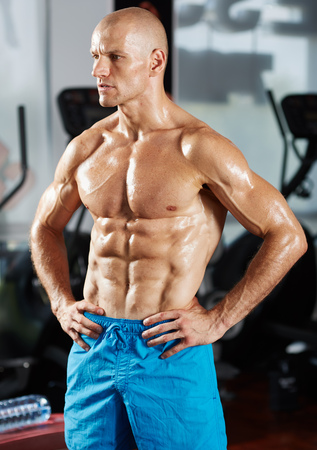 six packs: Portrait of a very fit athlete with six packs in a gym, with selective focus