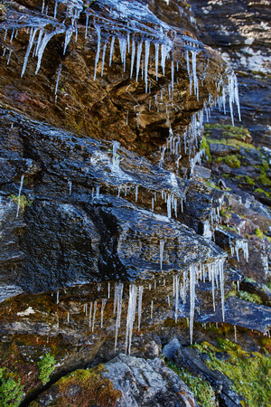 icicles: Icicles on rocks on a mountain in the autumn Stock Photo