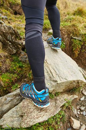 man outdoors: Closeup on legs of an ultramarathon trail runner in the mountains