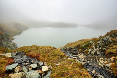glacial: Landscape with a glacial lake in the mist between mountains
