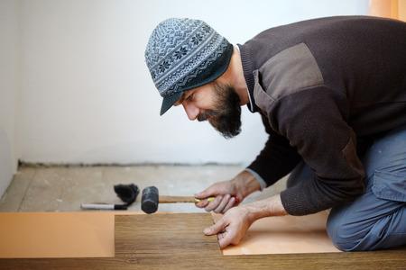 handy man: Handy man worker laying parquet in a room