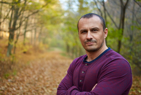 forties: Closeup portrait of a handsome caucasian man in his forties outdoor in the forest