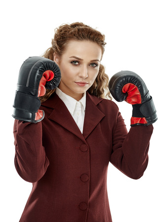 ambitious: Ambitious businesswoman with her boxing gloves on, ready to fight